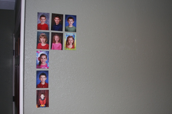 My husband's grandmother kept a wall in her office where she displayed every picture from all 7 grandkids from every school year! My in-laws have done the same on a wall in there basement with their 5 grandkids!